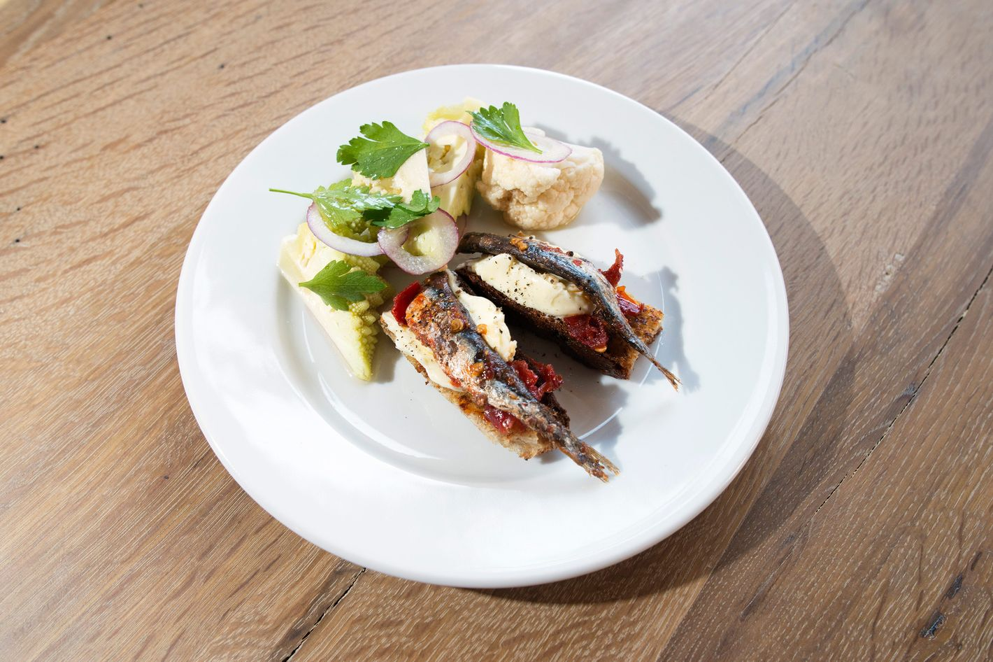 """Spicy anchovies on butter crostini. """"There will be a lot of anchovies,"""" says Mattos."""