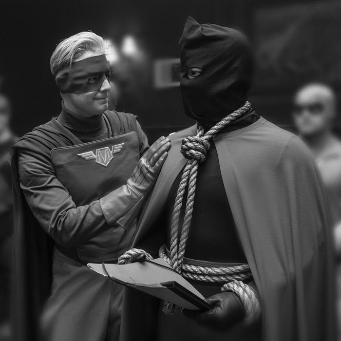 Captain Metropolis and Hooded Justice in Watchmen.