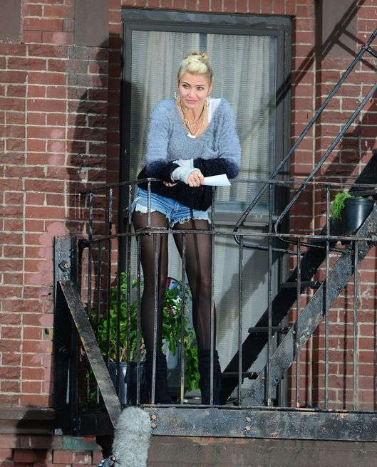 Cameron Diaz on a balcony in Harlmen during a scene for 'Annie' in New York City. <P> Pictured: Cameron Diaz <P><B>Ref: SPL649495  121113  </B><BR/> Picture by: Steffman-Turgeon / Splash News<BR/> </P><P> <B>Splash News and Pictures</B><BR/> Los Angeles:	310-821-2666<BR/> New York:	212-619-2666<BR/> London:	870-934-2666<BR/> photodesk@splashnews.com<BR/> </P>