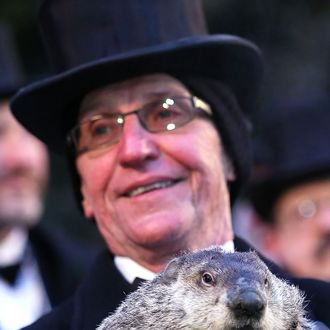 PUNXSUTAWNEY, PA - FEBRUARY 02: Groundhog co-handler Ron Ploucha holds Punxsutawney Phil after Phil didn't see his shadow and predicting an early spring during the 127th Groundhog Day Celebration at Gobbler's Knob on February 2, 2013 in Punxsutawney, Pennsylvania. The Punxsutawney 'Inner Circle' claimed that there were about 35,000 people gathered at the event to watch Phil's annual forecast. (Photo by Alex Wong/Getty Images)