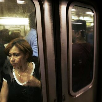 NEW YORK - AUGUST 02: A woman squeezes onto a crowded subway car at the Times Square station August 2, 2006 in New York City. Forecasters have called for high temperatures of 100 degrees in the city with the heat wave continuing through tomorrow. (Photo by Chris Hondros/Getty Images)