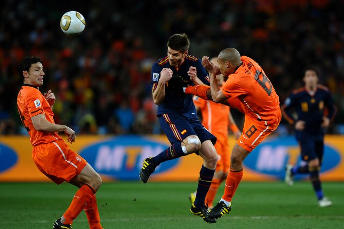 Nigel De Jong of the Netherlands tackles Xabi Alonso of Spain during the 2010 FIFA World Cup South Africa Final match between Netherlands and Spain at Soccer City Stadium on July 11, 2010 in Johannesburg, South Africa.
