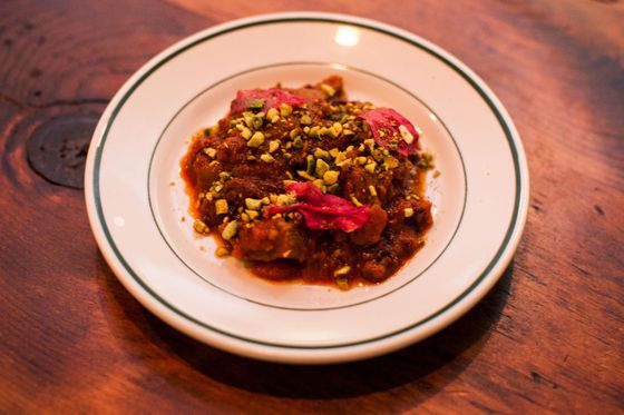 Lakh Lakh's lamb stew with barberries, pistachios, and fresh rose petals on top.