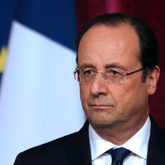 French President Francois Hollande pauses as he attends a news conference at the Elysee Palace in Paris, April 29, 2014.