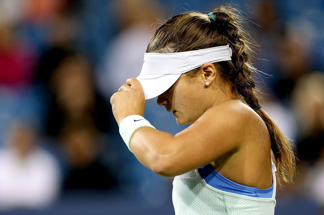 CINCINNATI, OH - AUGUST 14: Lauren Davis adjusts her visor between points while playing  Li Na of China during the Western & Southern Open on August 14, 2013 at Lindner Family Tennis Center in Cincinnati, Ohio.  (Photo by Matthew Stockman/Getty Images)