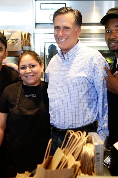 Republican presidential candidate, former Massachusetts Gov. Mitt Romney poses for a photo with workers as he makes an unscheduled stop at a Chipotle restaurant in Denver, Tuesday, Oct. 2, 2012.