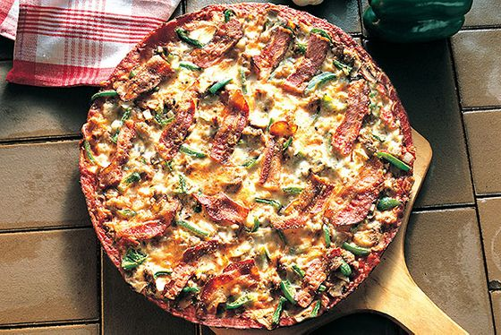 "<b>St. Louis–Style Pizza</b>    <a href=""http://imospizza.com/"">Imo's Pizza</a>    <i>St. Louis</i>  Just as Chicago is almost exclusively associated with deep-dish pizza, St. Louis is a city known for its fondness for incredibly thin crusts and a proprietary processed cheese blend called Provel (it's Cheddar, provolone, and Swiss). Imo's, a chain that dots the area, turns out what could be considered paragons of the form. In typical thin-crust fashion, the pizza itself is cut into squares, since the crust is too crispy to fold."