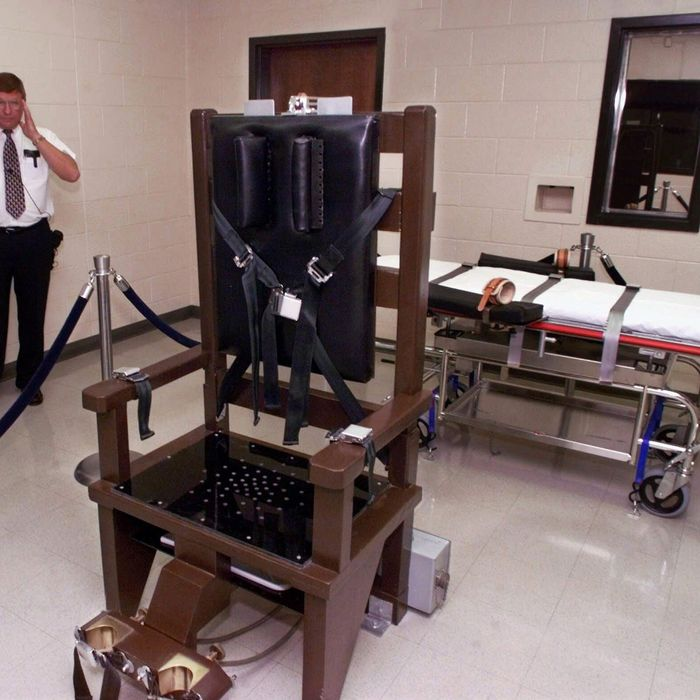 Ricky Bell, the warden at Riverbend Maximum Security Institution in Nashville, Tenn., gives a tour of the prison's execution chamber on Wednesday, Oct. 13, 1999. Both the electric chair and the lethal injection gurney are kept in the room until the time is near for a prisoner to be executed and the one not used is taken out. Robert Glen Coe, the prisoner most likely to be the first executed in Tennessee since 1960, has chosen lethal injection over the electric chair. (AP Photo/Mark Humphrey)