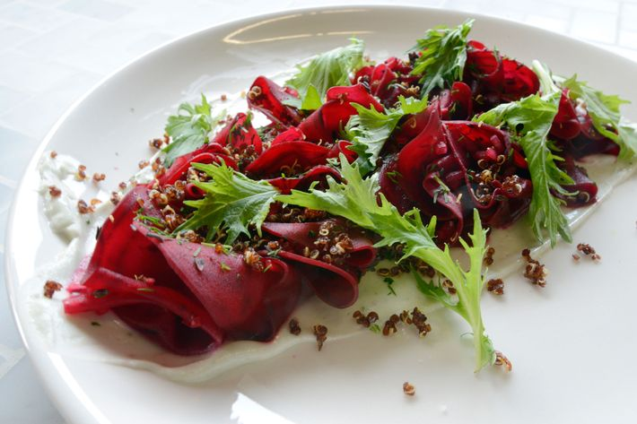 Shaved beets, blue cheese, and crispy quinoa.