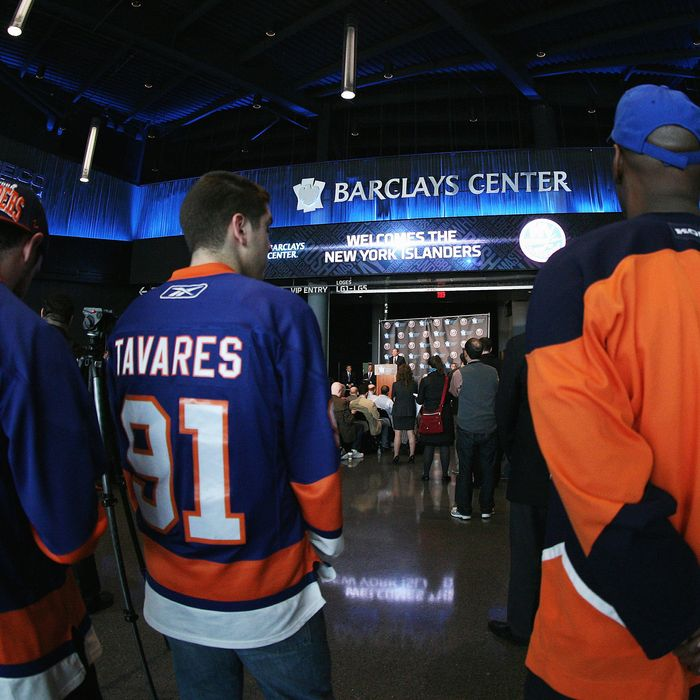 Fans congregate as New York Islanders owner Charles Wang announces the team's move to the Barclay Center in 2015 at a press conference at the Barclays Center on October 24, 2012 in the Brooklyn borough of New York City.