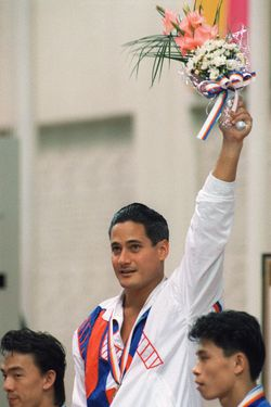 Two-time Los Angeles gold medalist Greg Louganis of the U.S. stands on the podium after winning the Olympic springboard competition, 20 September 2000 in Seoul.  (Photo credit should read BRIAN SMITH/AFP/Getty Images)