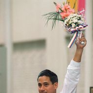 Two-time Los Angeles gold medalist Greg Louganis of the U.S. stands on the podium after winning the Olympic springboard competition, 20 September 2000 in Seoul.