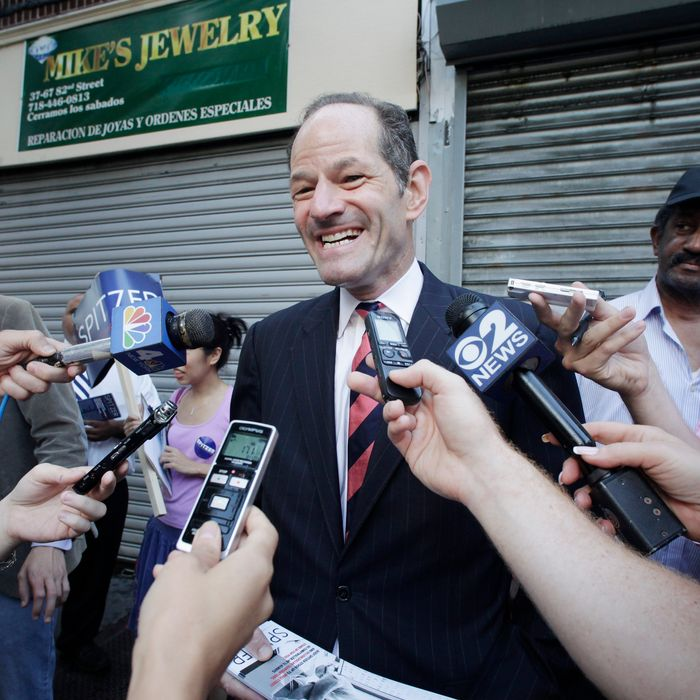 Eliot Spitzer, center, a candidate for New York City comptroller, talks with members of the media as he campaigns in the Jackson Heights neighborhood of the Queens borough of New York, Tuesday, July 23, 2013. Spitzer, who resigned as New York governor in 2008 after admitting he paid for sex with prostitutes, is now attempting a political comeback and is ahead of opponent Scott Stringer in the polls. (AP Photo/Mark Lennihan)