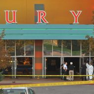 """AURORA, CO - JULY 20:  The Century 16 movie theatre is seen where a gunmen attacked movie goers during an early morning screening of the new Batman movie, """"The Dark Knight Rises"""" July 20, 2012 in Aurora, Colorado. According to reports, over 10 people have been killed and over 30 injured. Police have the suspect, twenty-four year old James Holmes of North Aurora, in custody.  (Photo by Thomas Cooper/Getty Images)"""