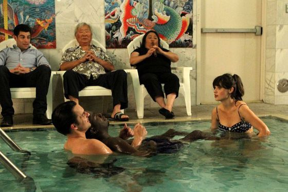 "NEW GIRL:  Nick (Jake Johnson, second from L) shows Winston (Lamorne Morris, third from R) and Jess (Zooey Deschanel, R) the benefits of water therapy while Schmidt (Max Greenfield, L) looks on in the ""M"
