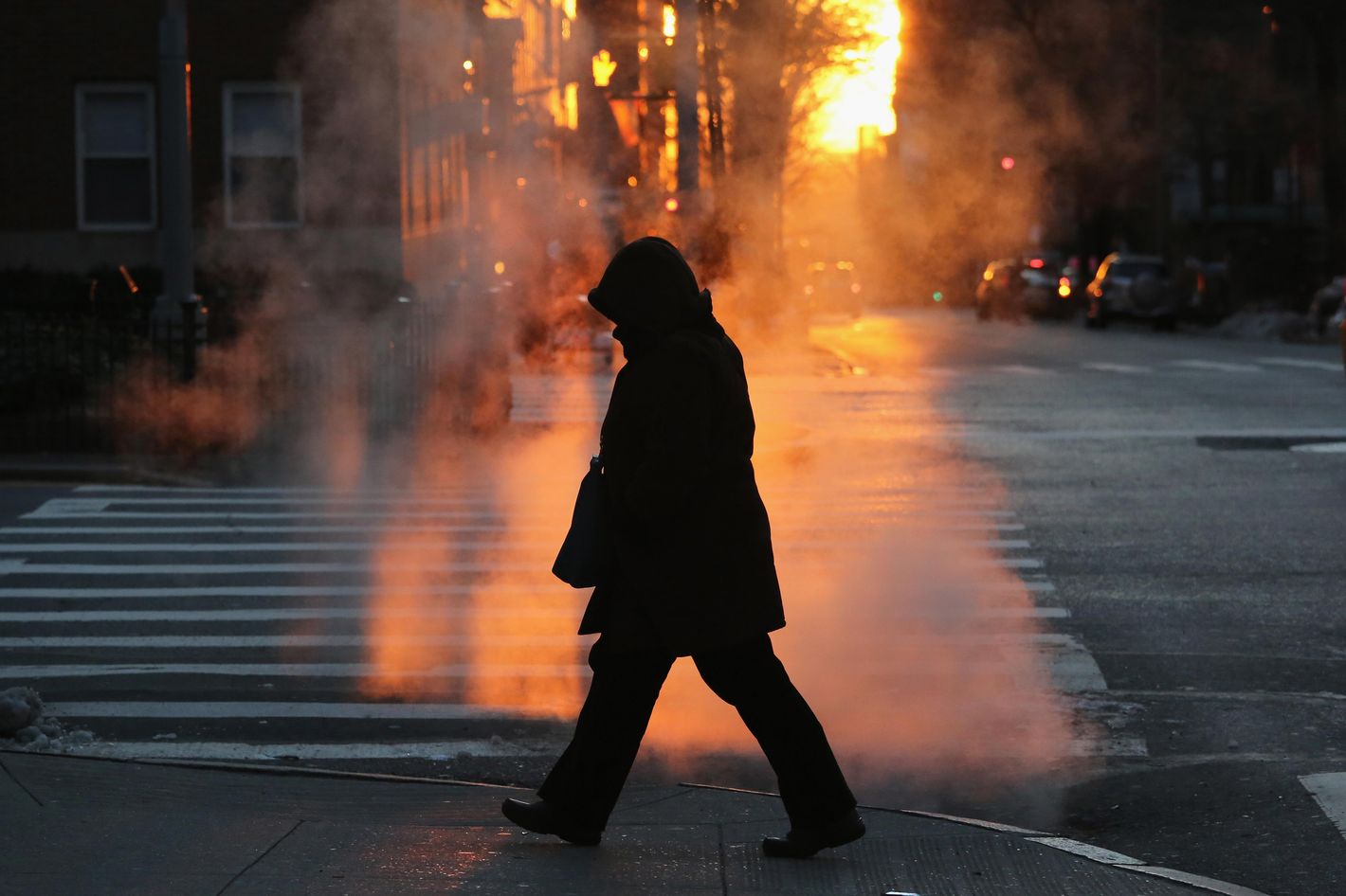 NEW YORK, NY - JANUARY 07:  A pedestrian braves the cold on January 7, 2014 in New York City. A 'polar vortex'  of frigid air centered on the North Pole dropped temperatures to a record low 4 degrees in New York City. (Photo by John Moore/Getty Images)