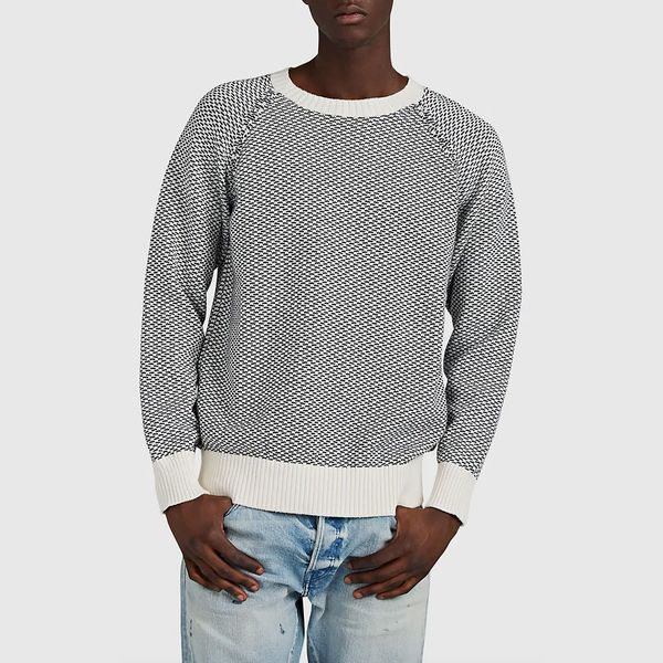 A navy blue and white patterned Cotton-Alpaca Jacquard Sweater from Barney New York paired with a light wash jean. 33 Things on Sale You'll Actually Want to Buy: From Adidas to Le Creuset - The Strategist