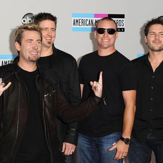 LOS ANGELES, CA - NOVEMBER 20: (L-R) Musicians Chad Kroeger, Daniel Adair, Mike Kroeger and Ryan Peake of Nickelback arrive at the 2011 American Music Awards held at Nokia Theatre L.A. LIVE on November 20, 2011 in Los Angeles, California. (Photo by Jason Merritt/Getty Images)