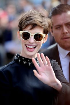 13 Dec 2012, Los Angeles, California, USA --- Anne Hathaway shows support to actor Hugh Jackman as he receives a Hollywood star. The 'The Dark Knight Rises' and 'Les Miserables' star turned up wearing sunglasses to the ceremony in Hollywood, CA. Pictured: Anne Hathaway.