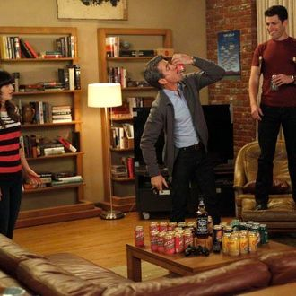 NEW GIRL: The gang plays drinking games when Jess (Zooey Deschanel, L) invites Russell (guest star Dermot Mulroney, C) to spend the weekend at the loft