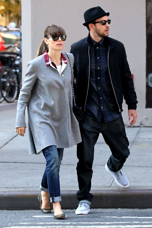 Newlyweds Justin Timberlake and Jessica Biel get dropped off by taxi at Regal Cinemas in Union Square (James Bond's 'Skyfall' perhaps) in New York City. Justin puts his arm around Jessica's shoulder as they cross Broadway.