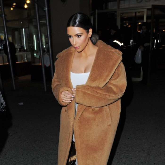 Kim Kardashian apparently stole someone's plush bathrobe.