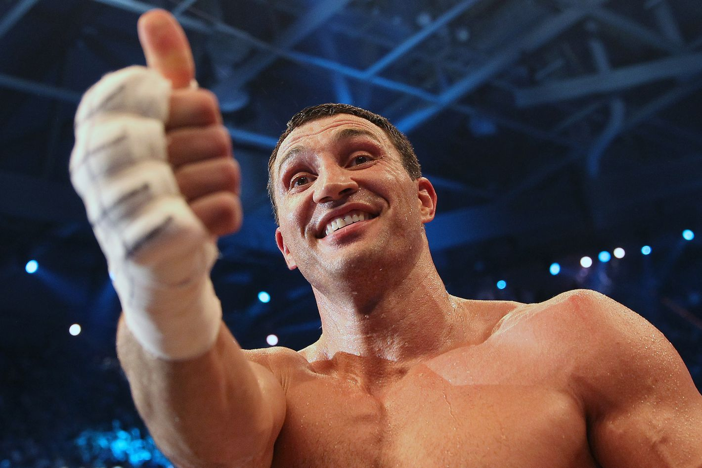 Ukrainian Heavyweight Champion Wladimir Klitschko gestures as he celebrates his win against challenger Italian-born Francesco Pianeta by knockout in round 6 in their IBO, IBF, WBO, WBA title fight in Mannheim, Germany on May 4, 2013.