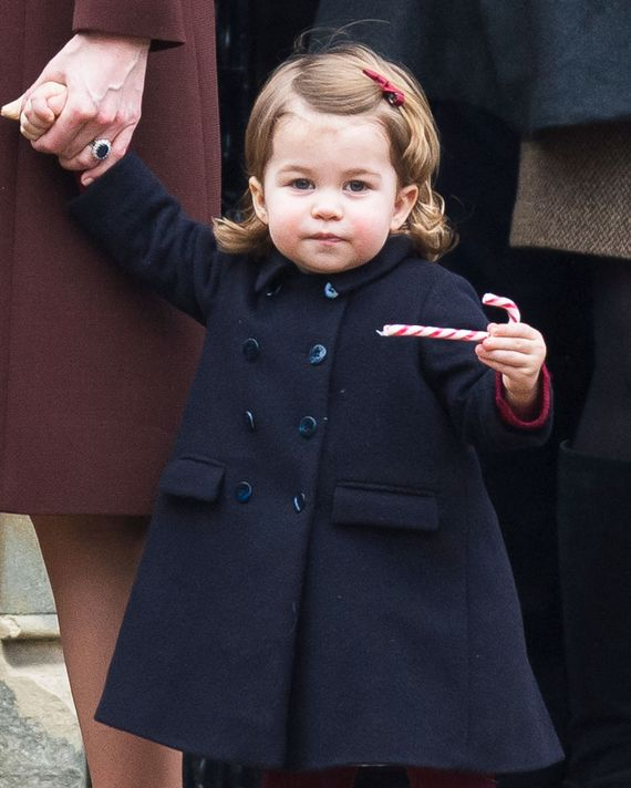 Princess Charlotte with a holiday snack (a candy cane).