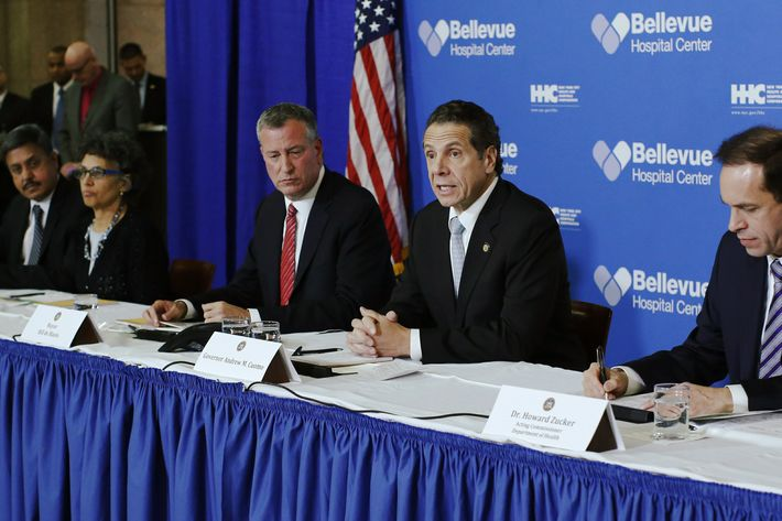 New York, United States. 23rd October 2014 -- New York Mayor Bill de Blasio and New York Governor Andrew Cuomo attend a press conference at Bellevue Hospital in Manhattan after a doctor who treated Ebola patients in West Africa before returning to New York tested positive for Ebola. -- A doctor who treated Ebola patients in West Africa before returning to New York has tested positive for Ebola. Dr Craig Spencer is thought to have contracted the virus while working for the charity Medecins Sans Frontieres in Guinea.