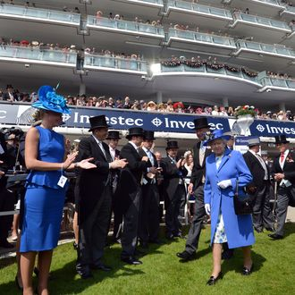 EPSOM, ENGLAND - JUNE 02: Queen Elizabeth II walks out to present the trophies for the winning horse St Nicholas Abbey in the Diamond Jubilee Coronation Cup race on Derby Day on June 2, 2012 in Epsom, England. For only the second time in its history, the UK celebrates the Diamond Jubilee of a monarch. Her Majesty Queen Elizabeth II celebrates the 60th anniversary of her ascension to the throne. The Queen along with all the members of the royal family will participate in a River Pageant with a flotilla of 1,000 boats accompanying them down the Thames, a star studded free concert at Buckingham Palace, and a carriage procession and a Service of Thanksgiving at St Paul's Cathedral. (Photo by Ben Stansall - WPA Pool /Getty Images)