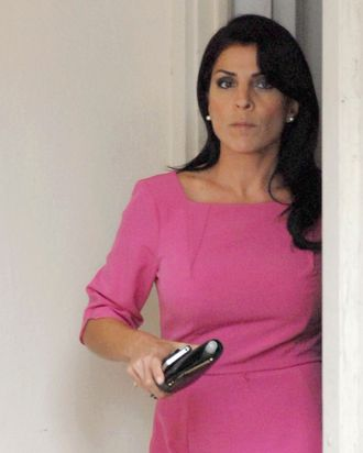 TAMPA, FL - NOVEMBER 13: Jill Kelley leaves her home on November 13, 2012 in Tampa, Florida. Kelley, who is reported to be involved with the military community at MacDill Air Force Base, reported receiving harassing emails to the FBI, which resulted in an investigation that revealed the sender to be Paula Broadwell, who was found to be having an affair with Gen. David H. Petraeus. (Photo by Tim Boyles/Getty Images)