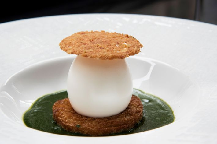 Eggs mollet with parsley velouté and chicken jus.