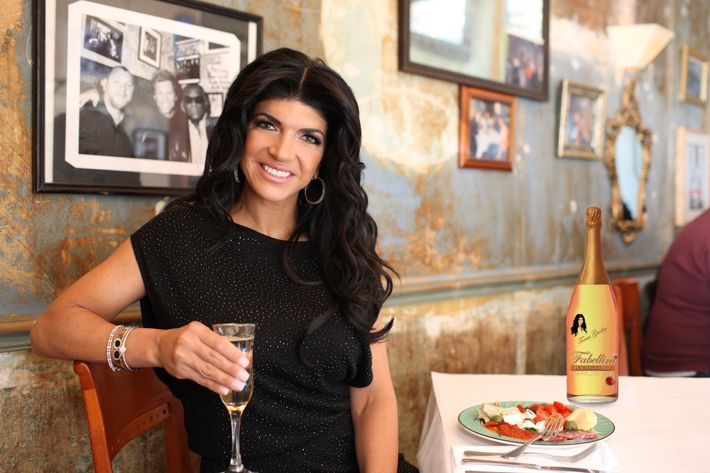 "Teresa with her ""Fabellini"" bottle at Ballato, an old date spot for her and Joe."