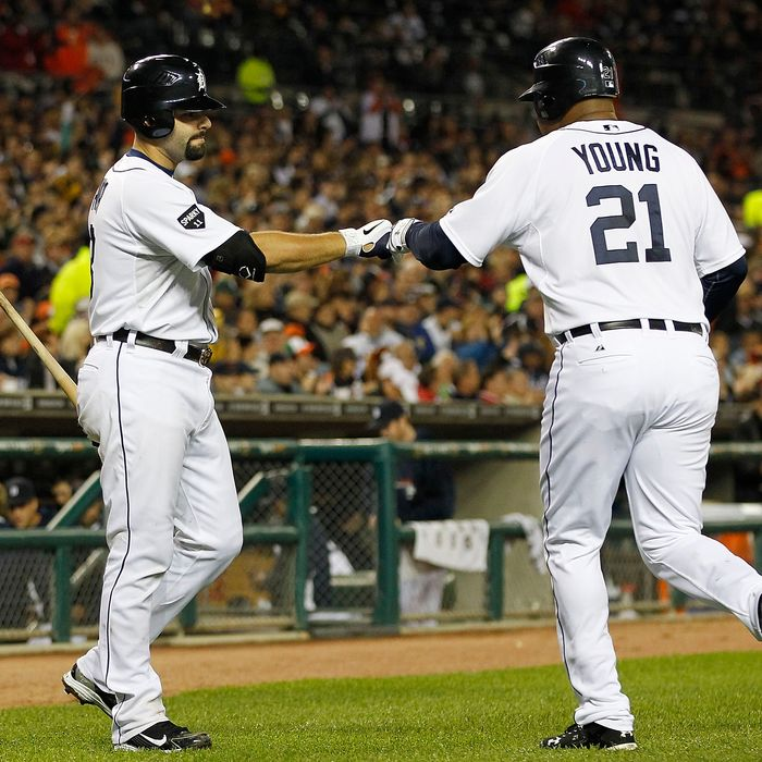 DETROIT - SEPTEMBER 28: Delmon Young #21 of the Detroit Tigers is congratulated by teammate Alex Avila #13 after scoring on a Victor Martinez single to right field in the fifth inning of the game against the Cleveland Indians during the game at Comerica Park on September 28, 2011 in Detroit, Michigan. The Tigers defeated the Indians 5-4. (Photo by Leon Halip/Getty Images)