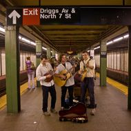 NEW YORK, NY - MAY 5: A group of musicians play their instruments in a Williamsburg subway station on May 5, 2012 in New York City. Over the past five years, Williamsburg has become a magnet for youthful artists, musicians, chefs, mixologists and fashion designers. (Photo by George Rose/Getty Images)