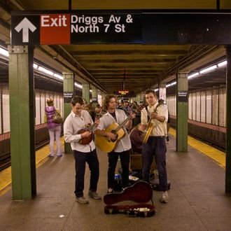 A group of musicians play their instruments in a Williamsburg subway station on May 5, 2012 in New York City. Over the past five years, Williamsburg has become a magnet for youthful artists, musicians, chefs, mixologists and fashion designers.