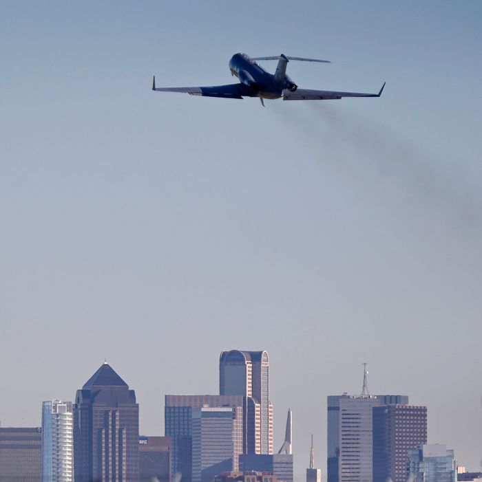 DALLAS, TX - OCTOBER 15: An air ambulance carrying Amber Vinson takes off from Love Field Airport October 15, 2014. According to reports, Vinson, a healthcare worker, had contracted the Ebola virus and had taken a commercial Frontier Airlines flight from Cleveland, Ohio to Dallas, Texas, a day before become symptomatic. (Photo by Stewart F. House/Getty Images)