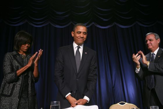 First lady Michelle Obama (L) and U.S. Rep Jeff Miller (R-FL) (R) applaud U.S. President Barack Obama during the National Prayer Breakfast at the Washington Hilton February 3, 2011 in Washington. DC. Obama talked about his own faith, the events in Egypt and the recovery of U.S. Rep. Gabrielle Giffords (D-AZ), whose husband was in attendance.