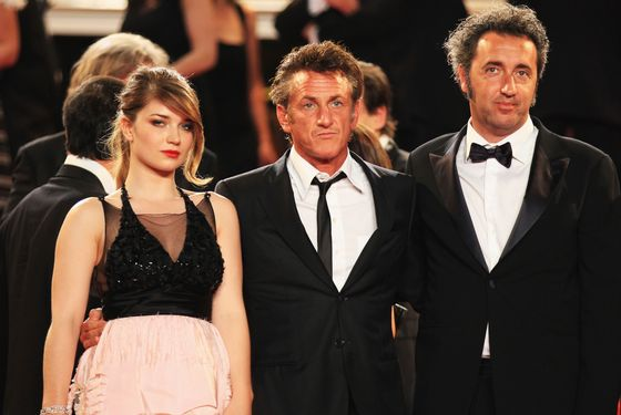 "CANNES, FRANCE - MAY 20:  (L-R)  Eve Hewson,  Sean Penn and Paolo Sorrentino depart the ""This Must Be The Place"" premiere during the 64th Annual Cannes Film Festival at Palais des Festivals on May 20, 2011 in Cannes, France.  (Photo by Andreas Rentz/Getty Images)"