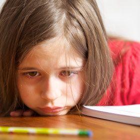 Little student looks sad or bored