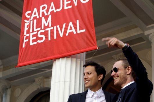 "Irish actor Michael Fassbender (R) and American director Cary Fukunaga walk on the red carpet at the entrance of the Bosnian National Theatre on the 6th night of the 17th Sarajevo Film Festival, before the projection of Fukunaga's recent film ""Jane Eyre"", in Sarajevo, on July 27, 2011."