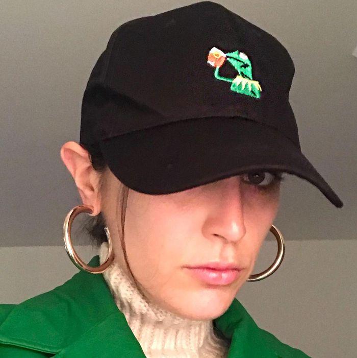 The author, Rio Viera Newton, wearing a hat.
