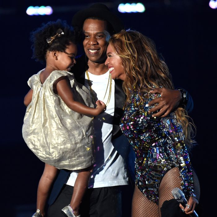 INGLEWOOD, CA - AUGUST 24: Blue Ivy Carter, Jay-Z and Beyonce onstage during the 2014 MTV Video Music Awards at The Forum on August 24, 2014 in Inglewood, California. (Photo by Kevin Mazur/MTV1415/WireImage)