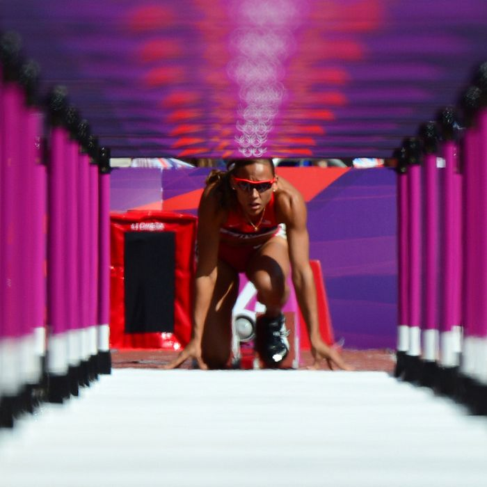 US' LoLo Jones gets ready for the start of the women's 100m hurdles heats at the athletics event of the London 2012 Olympic Games on August 6, 2012 in London.