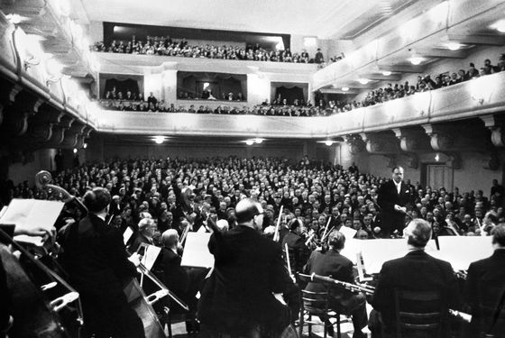 January 29. 1956, Salzburg, Austria --- Original caption: A public Mozart concert with international guests from all over the world took place at the famous Salzburg Festival Hall on the noon of the anniversary day of Mozart's 250th birthday.  Karl Boehm conducted the Vienna Philharmonic Orchestra.  President Theodor Koerner, the Austrian government, the Diplomatic Corps attended the concert.