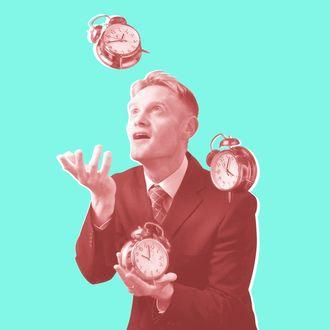 Businessman juggling with alarm clocks.