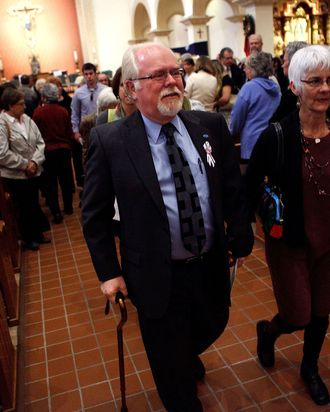 TUCSON, AZ- JANUARY 8: Ron Barber (center), who was wounded in last years deadly shooting, exits after attending an interfaith memorial service held at St. Augustine Cathedral January 8, 2012 in Tucson, Arizona. Memorial services will be held throughout the day in Tucson to commemorate the one year anniversary of a shooting rampage that killed six people and wounded more than a dozen more including U.S. Rep. Gabrielle Giffords (D-AZ). (Photo by Jonathan Gibby/Getty Images)
