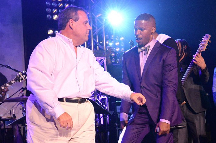 EAST HAMPTON, NY - AUGUST 16:  New Jersey Governor Chris Christie dances onstage with Jamie Foxx at Apollo in the Hamptons at The Creeks on August 16, 2014 in East Hampton, New York.  (Photo by Kevin Mazur/WireImage)