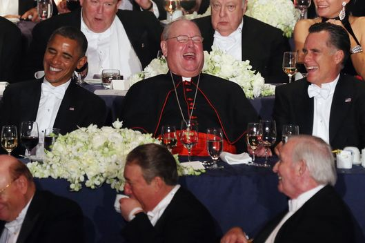 NEW YORK, NY - OCTOBER 18:  (L - R) U.S. President Barack Obama, Roman Catholic Cardinal and Archbishop of New York Timothy Dolan, and Republican presidential candidate Mitt Romney share a laugh at the 67th Annual Alfred E. Smith Memorial Foundation Dinner at the Waldorf-Astoria Hotel on October 18, 2012 in New York City. The lighthearted white-tie charity gala has long been a tradition of the presidential race. (Photo by Mario Tama/Getty Images)