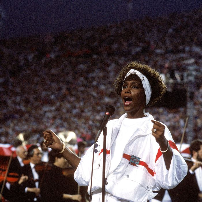 Whitney Houston sings the National Anthem before a game with the New York Giants taking on the Buffalo Bills prior to Super Bowl XXV at Tampa Stadium on January 27, 1991 in Tampa, Florida. The Giants won 20-19.